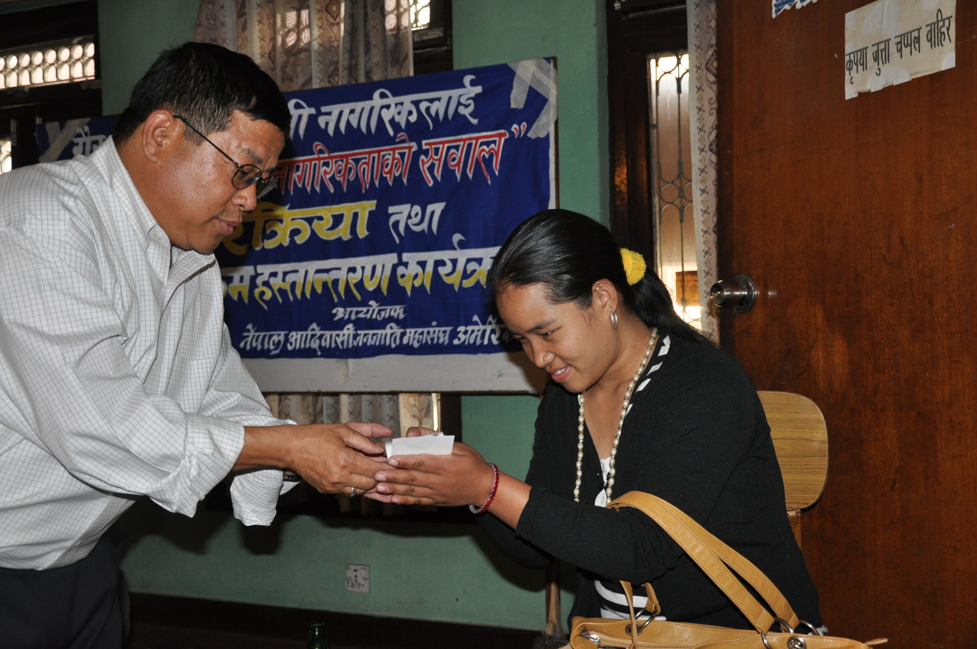 President Shiv K Rai handing over the donation.