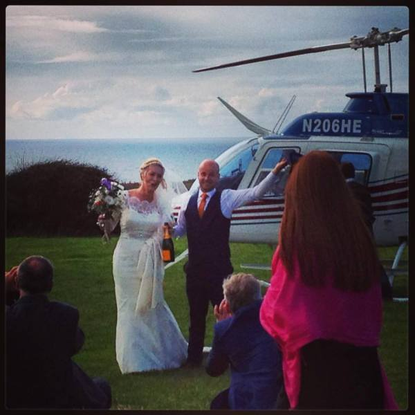 The wedding couple arriving by helicopter