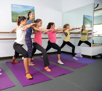 young teenage girls at a yoga class
