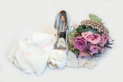 collection of brides accessories including Mrs knickers, bridal shoes and bouquet