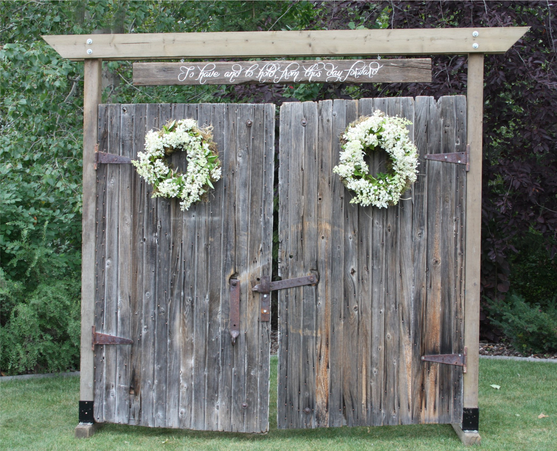 100 year old weathered grey barn doors available for rent as unique backdrop