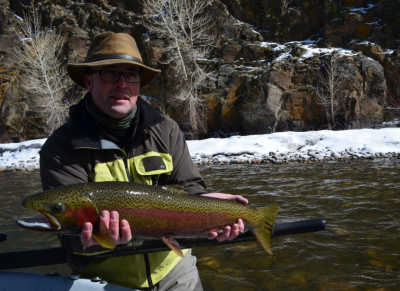 Josh with a dandy steelhead caught on a fly he tied himself
