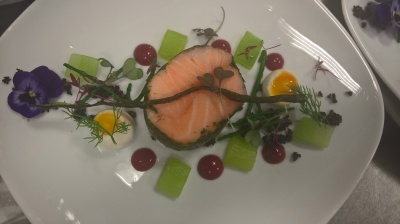 Herb poached salmon compressed cucumber beet and quail