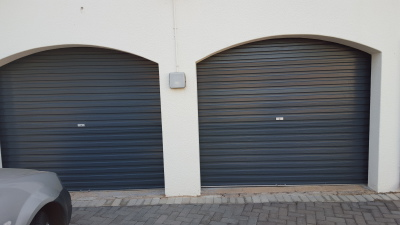 Install two new motorized garage doors