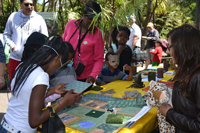 Kids engaged in the Habitat Connection puzzle
