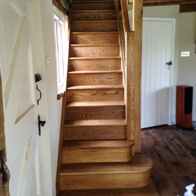 Sanding and treating oak staircase.