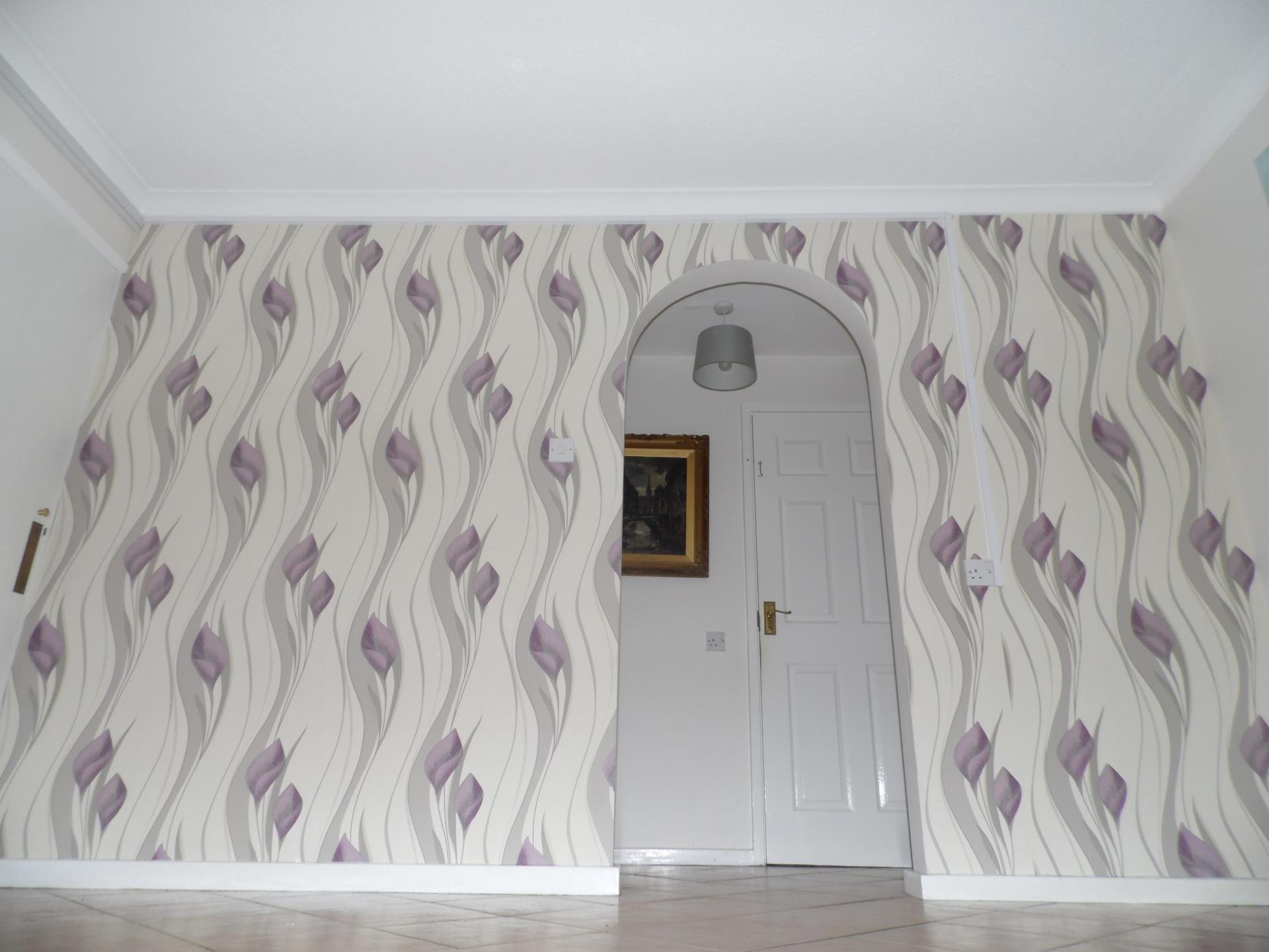 Wallpaper hanging.