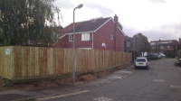close board fencing using wooden posts and gravel boards