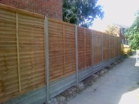 Panels using concrete posts and gravel boards