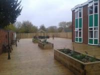 Decking.Raised flower beds using sleepers.Close board fencing. Decorative lighting