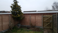 lap  panels.concrete posts and concrete gravel boards.6 foot close board gate