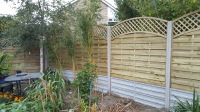 Omega lattice panels.10 foot concrete posts.concrete gravel boards