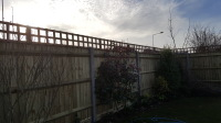 Close board fencing using concrete posts and gravel boards