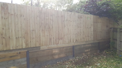 3 ft retaining wall using sleepers and steel posts.6ft close board fencing  in milton keynes