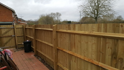 6ft close board fencing.5 x 4 inch v-notch posts.ariss rails.gravel boards and featheredge boards