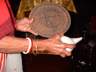 My mother holding Kali's footprints, a plate blessed by Shiddha Ma.