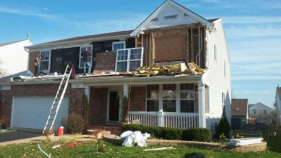 Replacing brick and windows after water damage with vinyl siding