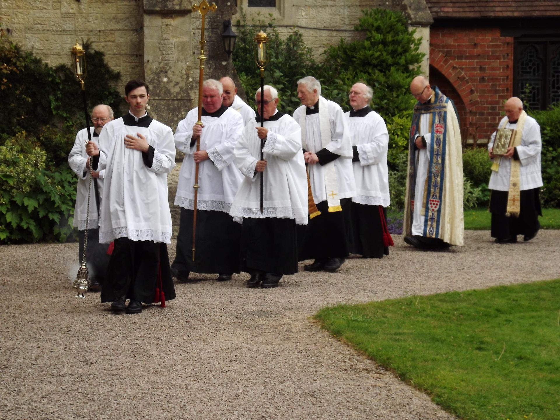 The procession makes its way across the Quadrangle