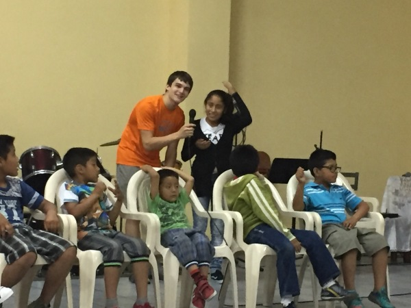 Harrison Ivins on a mission trip at Lima, Peru, with kids from an orphanage that came to the church