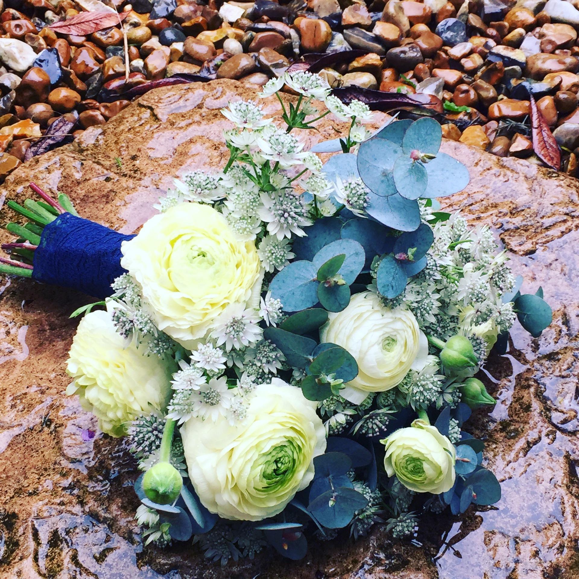 Ranunculus and Eucalyptus spring bridal bouquet