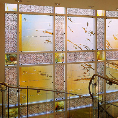 gold & cooper leaf glass window in foyer gives warm welcome to visitors at the Embassy of Kuwait