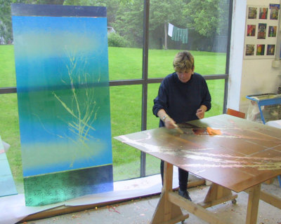 Sarah Hall gold leafing glass in the studio