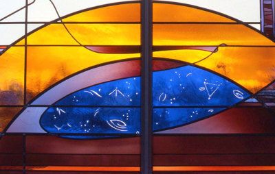golden arcs of glass and blue heavens in stained glass