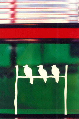 white birds on a wire in stained glass by Sarah Hall