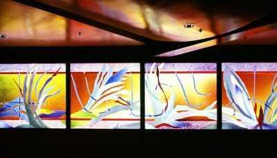 sunlight makes colourful reflections from stained glass by Sarah Hall