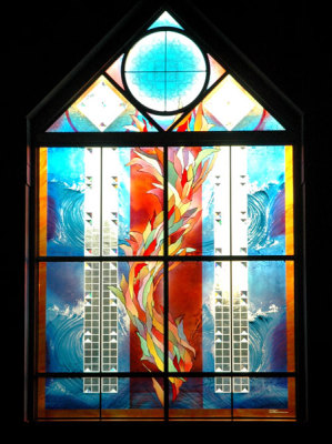 spiral of fire and light with prisms in stained glass by sarah hall