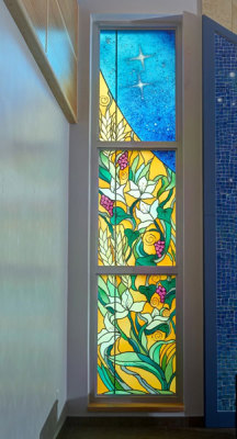 symbolic windows with lilies for Mary and wheat and grapes for the Eucharist
