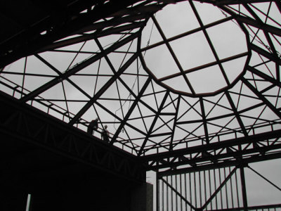 scale for the vast oculus is given by the two men at lower left.