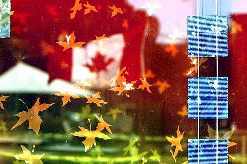 Canadian flag is reflected the solar window by Sarah Hall