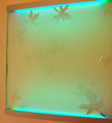 LED glass fixture is powered by solar energy from art glass window