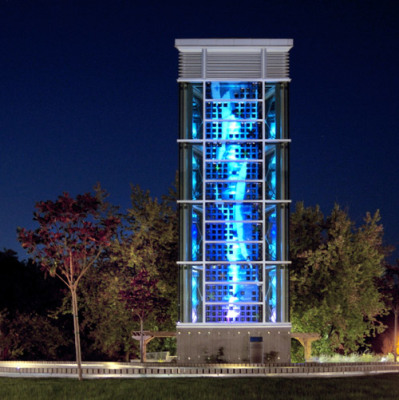 this wind tower by Sarah Hall has embedded solar cells and blue painted glass