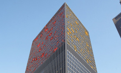 high rise office building with solar glass to prevent bird collisions
