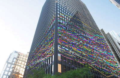 high rise office building and colourful solar glass to prevent bird collisions