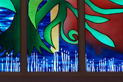 "painted trees on glass and candles in the ""Glory"" window by Sarah Hall"