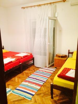 beds with balcony door