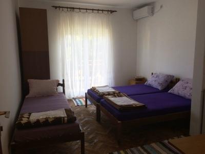 three beds with balcony door