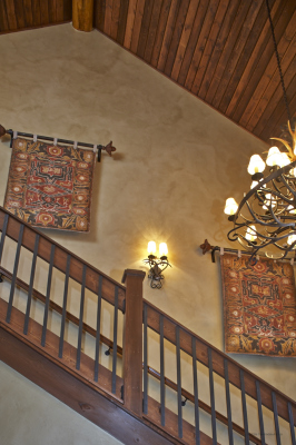 Tapestries in elevated staircase in Pole Creek home, Tabernash, Colorado