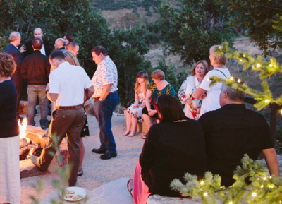 Events Rising corporate event of people gathered around a firepit in the mountains of Park City, Utah