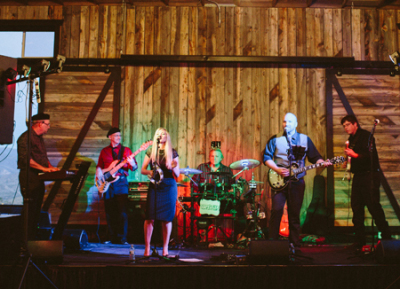 Band playing in a barn to an audience