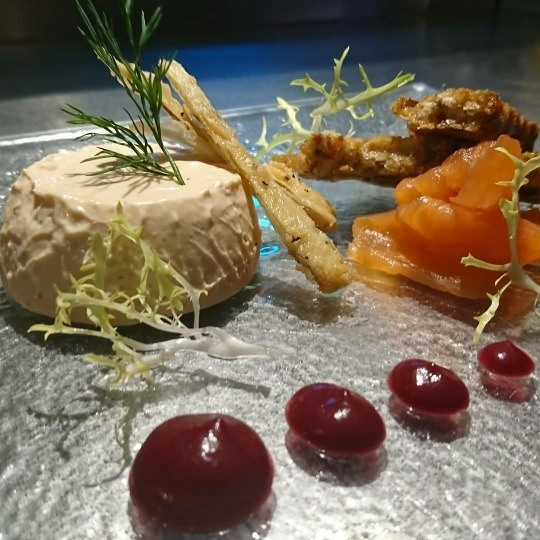 Goat's cheese pannacota, with cranberry sauce and parsnip curls