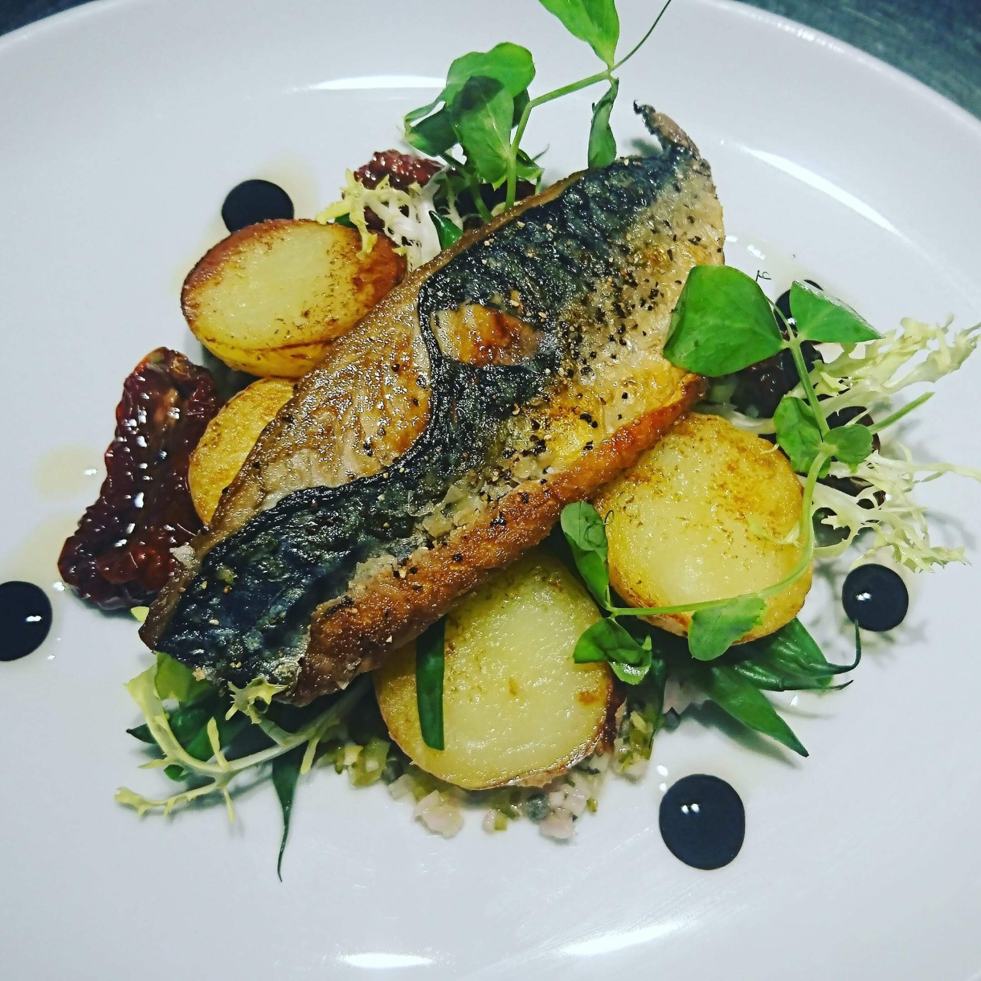 Pan fried mackerel fillet on new potatoes