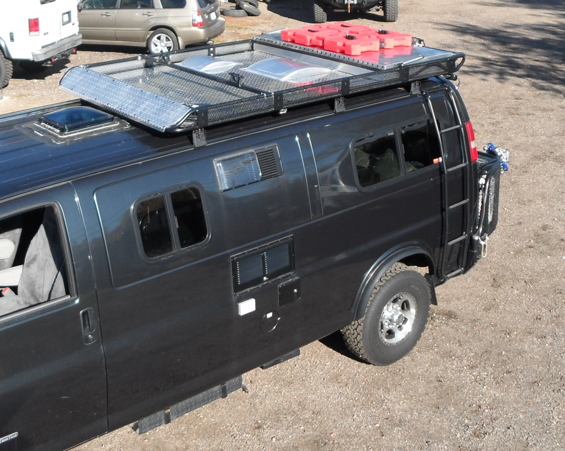 Lifted 2wd Chevy Express camper van