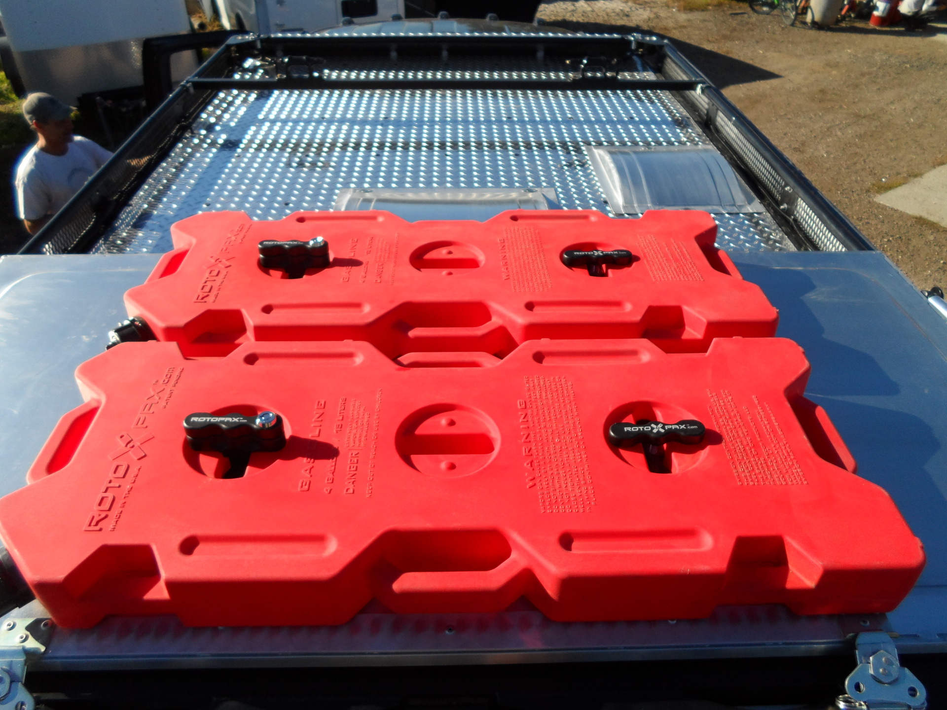 Chevy Express Roof rack with Rotopax and custom solar panel mounts