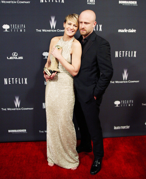 Robin Wright with her Golden Globe and Ben Foster.