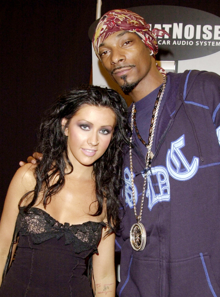 Exclusive photo: Christina Aguilera and Snoop Lion at MTV Video Music Awards Backstage.