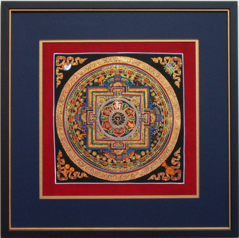 painting matted with gold and blue mats with black frame with gold trim